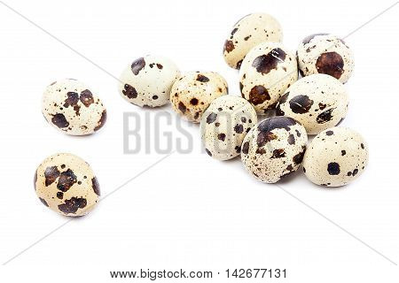 Quail eggs isolated on a white background.