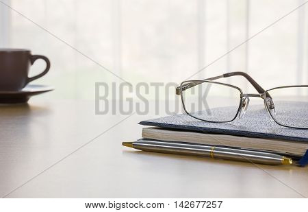 Glasses And Book On The Desk