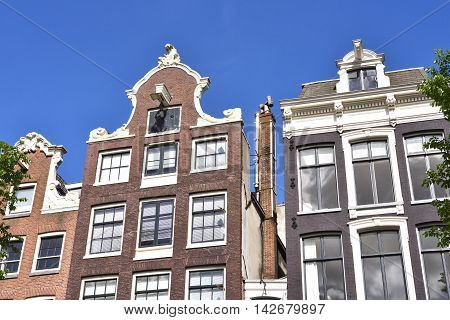 Old dutch houses in Amsterdam, the Netherlands.
