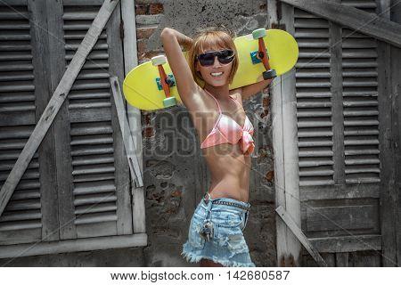 Skating girl against grange wall