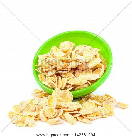 Cornflakes in the green bowl isolated on white background.