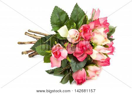 Beautiful bouquet of artificial roses isolated on white background.