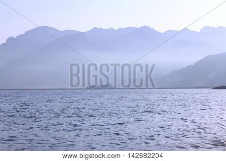 Sea coast with mountains, dock and ship in Salerno, Italy