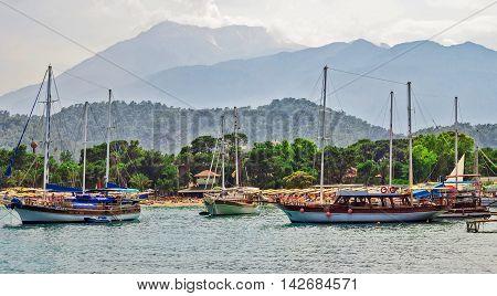 Passenger boats in Mediterranean sea. Kemer Antalya Turkey. Moonlight beach