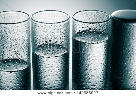 A row of glasses for vodka. studio shot