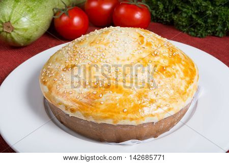 Fresh baked yellow pie on a white plate