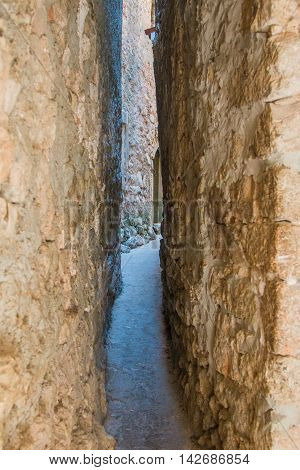 Narrowest street in the world in old town Vrbnik on the island of Krk, Croatia, Mediterranean ambient