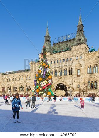 Moscow - November 29 2015: Christmas ice rink on Red Square a beautiful and a lot of people are skating in the winter holidays and unusual Christmas tree November 29 2016 Moscow Russia
