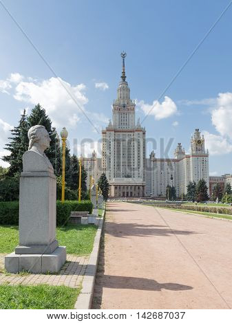 Moscow - August 11 2016: Beautiful Moscow State University named after Lomonosov on the Sparrow Hills and sculpture bust of Lomonosov August 11 2016 Moscow Russia