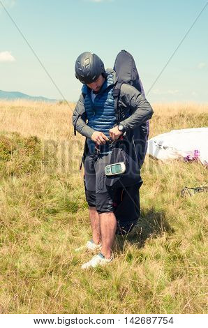 Male Paraglider Preparing His Equipment For Flying