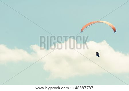 Paraglider In The Blue Cloudy Sky