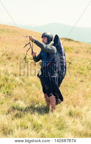 Paraglider Preparing Ropes For Taking Off