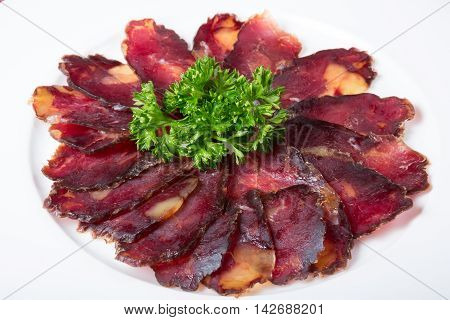 Smoked and sliced jerk meat or prosciutto