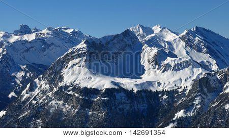 Winter scene in the Swiss Alps. View from Mt Klingenstock.