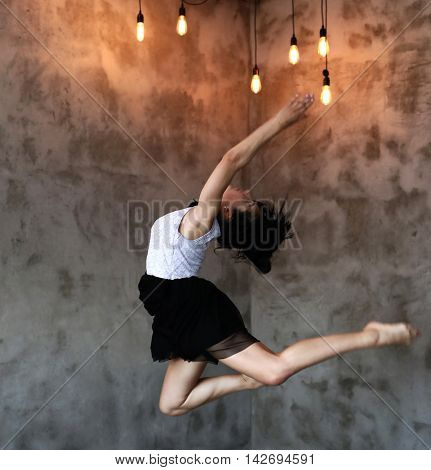 Flexible woman in mid air