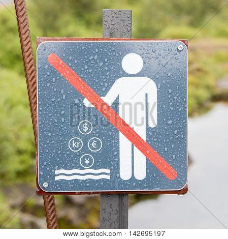 No Coins in the Water - Forbidden Sign in Iceland