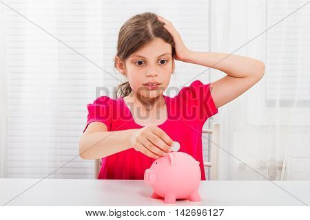 Cute little girl is in panic because of her savings.