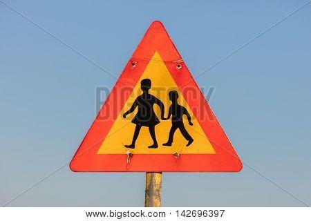 Warning Sign Of Children Crossing Street From School