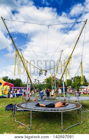 Perekhrest Ukraine - August 14. 2016: Man sleeping on a trampoline during the first festival of hunters.