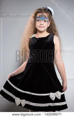 Young Girl Posing In Black Dress