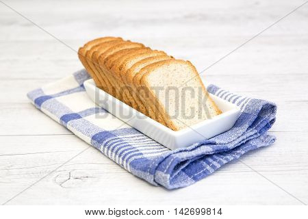 A Group Of Rusks On A White Platter