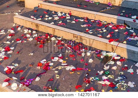 confetti fell on the day of the wedding on the steps