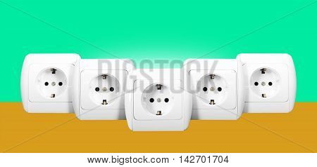 Electrical grid - The five white electric socket with grounding on a green and orange background.