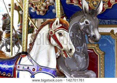 Carousel Horse on a brass pole on a merry go round