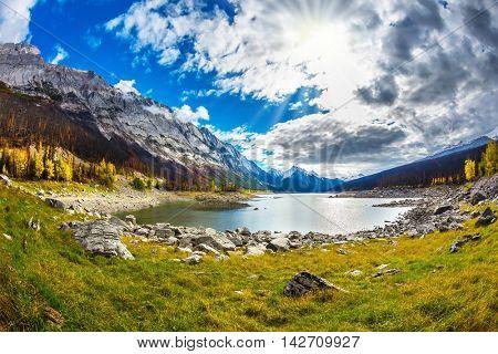 Fall to Jasper national park, Canada. Stony coast of the shoaled Medicine Lake