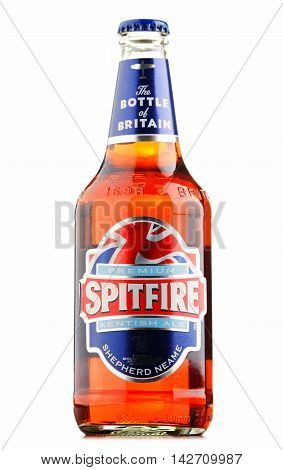 POZNAN POLAND - AUGUST 12 2016: Spitfire Premium Kentish Ale is the best-selling cask conditioned ale of Shepherd Neame an English independent regional brewery from Faversham Kent