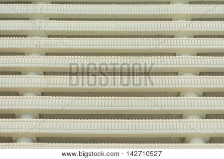 White texture of plastic swimming pool drain.