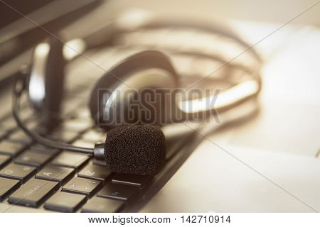 Headpset on laptop computer high quality studio shot