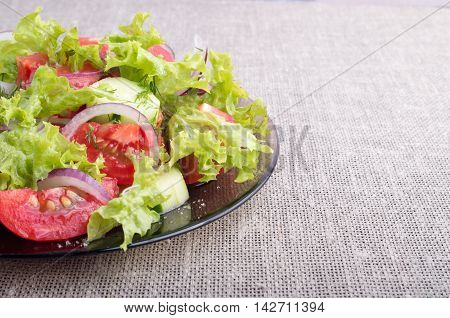 Side View Of A Plate Of Fresh Salad Of Raw Vegetables Closeup