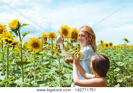 mother and daughter in the sunflower field