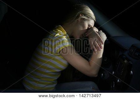Tired beautiful woman falling asleep in car
