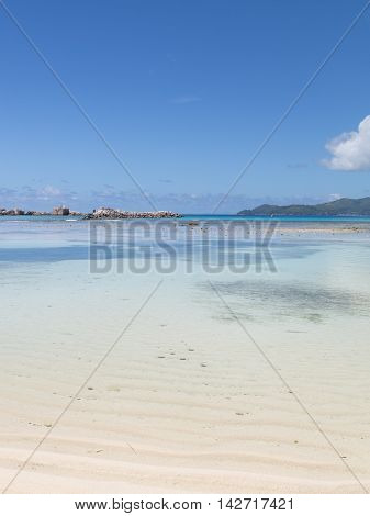 Calm clear warm water in the sea in the Seychelles and the nice weather