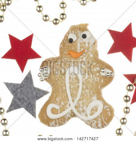 funny tasty gingerbread man decorated with a pattern of sweet sugar fondant and sugar silver balls and stars and decorative gold beads on a white background isolated