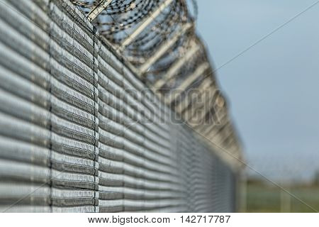 Close up of barbwire fence against illegal immigration