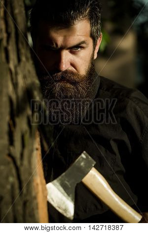 Bearded Man Outdoor With Axe
