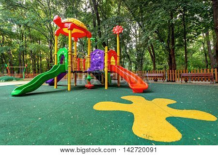 Children playground in the park. Colorful playground in public park.