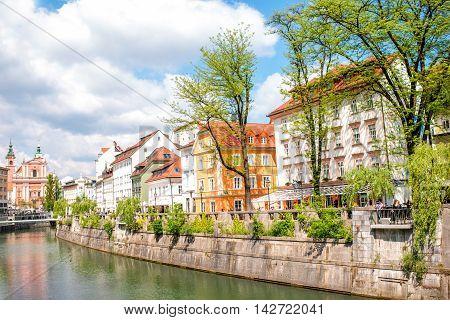 Ljubljana, Slovenia - May 6, 2016: Cityscape view on Ljubljanica river canal in Ljubljana old town. Ljubljana is the capital of Slovenia and famous european tourist destination.