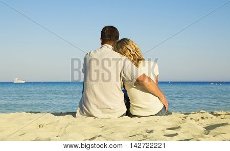 couple in love on the shore of the sea