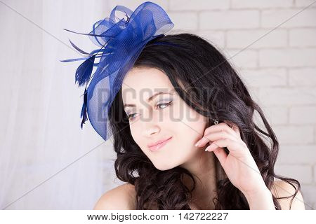 Dreamy girl with blue eyes in blue hat