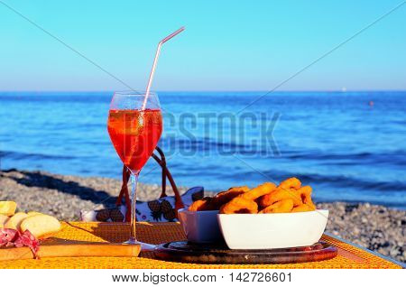 a glass of Aperol Spritz on the beach, albissola, italy