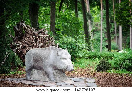 Sculpture of wild boar in forest  of Latvia