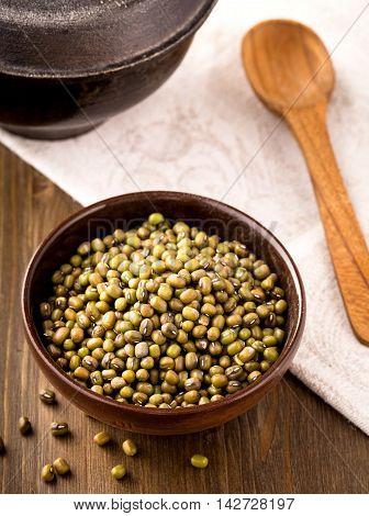 Bowl of green mung bean above shot