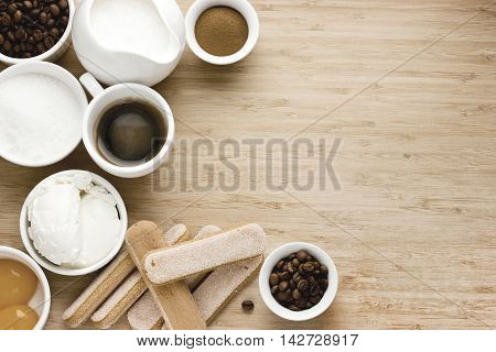 Tiramisu ingredients. Cooking classical Italian dessert concept background. Top view with copy space