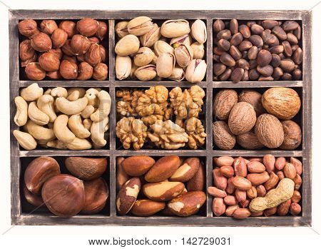 Rectangular box of variety nuts top view isolated on white