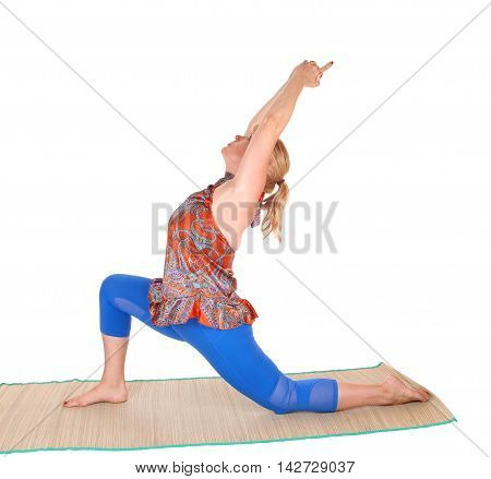 A pretty woman with blond hair stretching on a matt with a yoga pose isolated for white background.