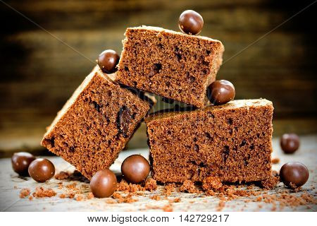 Cake chocolate brownies on wooden background selective focus